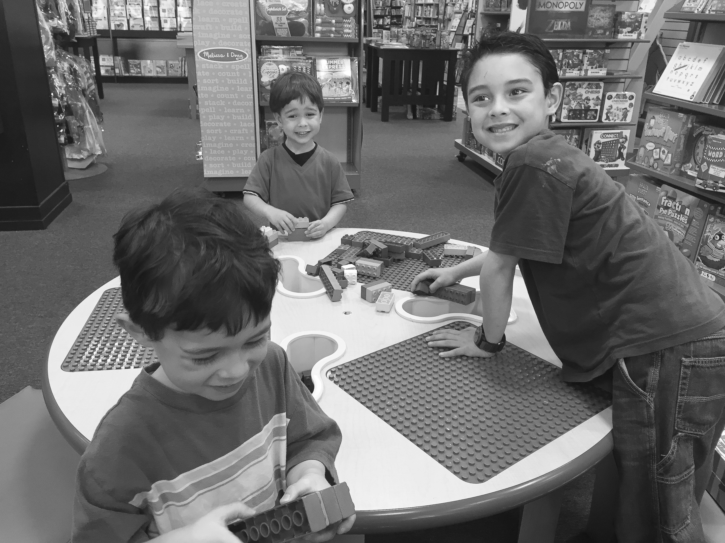 2015 - the boys enjoying playing around at Barnes and Noble bookstore before deciding on what to buy. The girls in the meantime were trying to decide on buying a Bible case, a book, or saving up for something else.