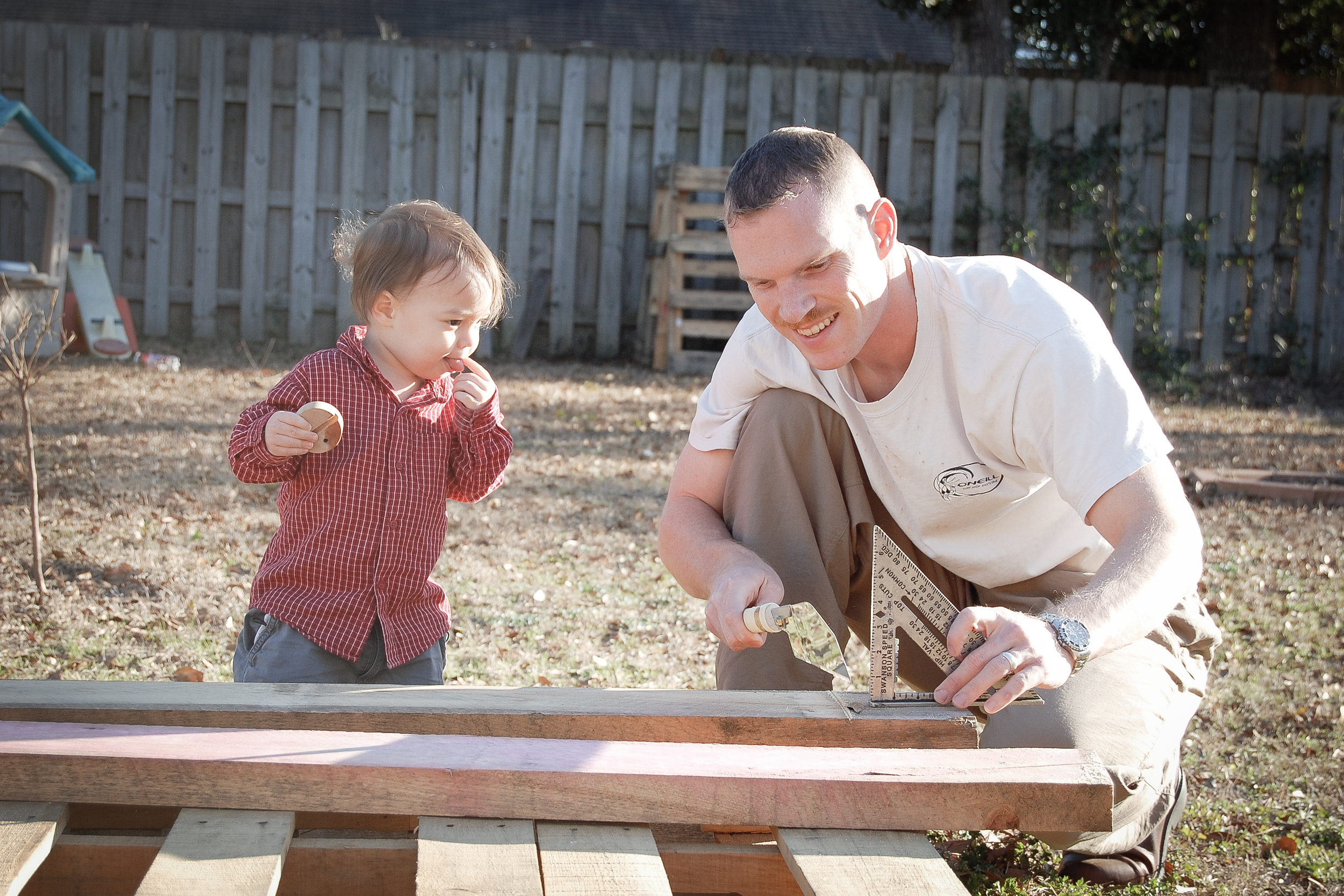 2009 - 1-year-old Abraham watches his daddy use his Japanese saw to make our raised beds for our organic square-foot gardens