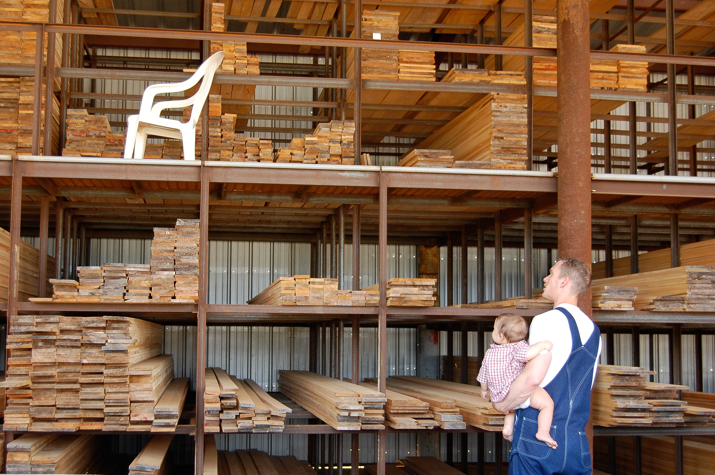 2008 - 11-month-old Abraham watches as Daddy chooses wood at the lumber mill