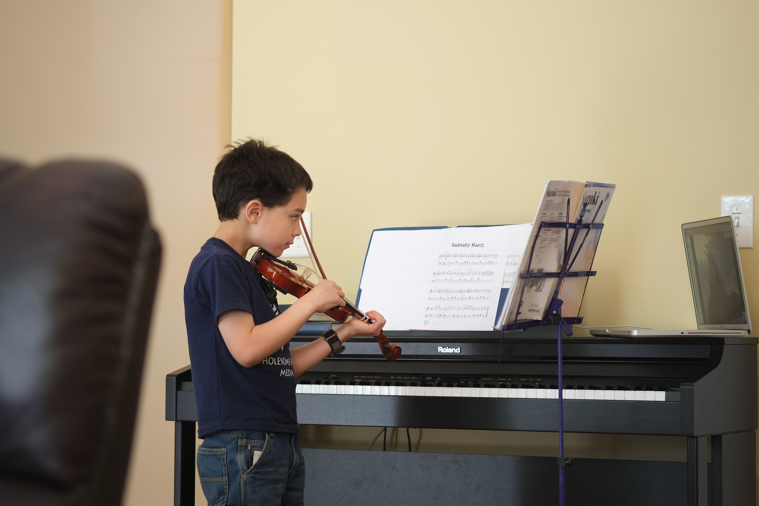2015 - Abraham focusing on the instructions from his piano and violin instructor. When we moved, we transferred from private home lessons to using Skype with the same instructor. He is still a very diligent and patient student.