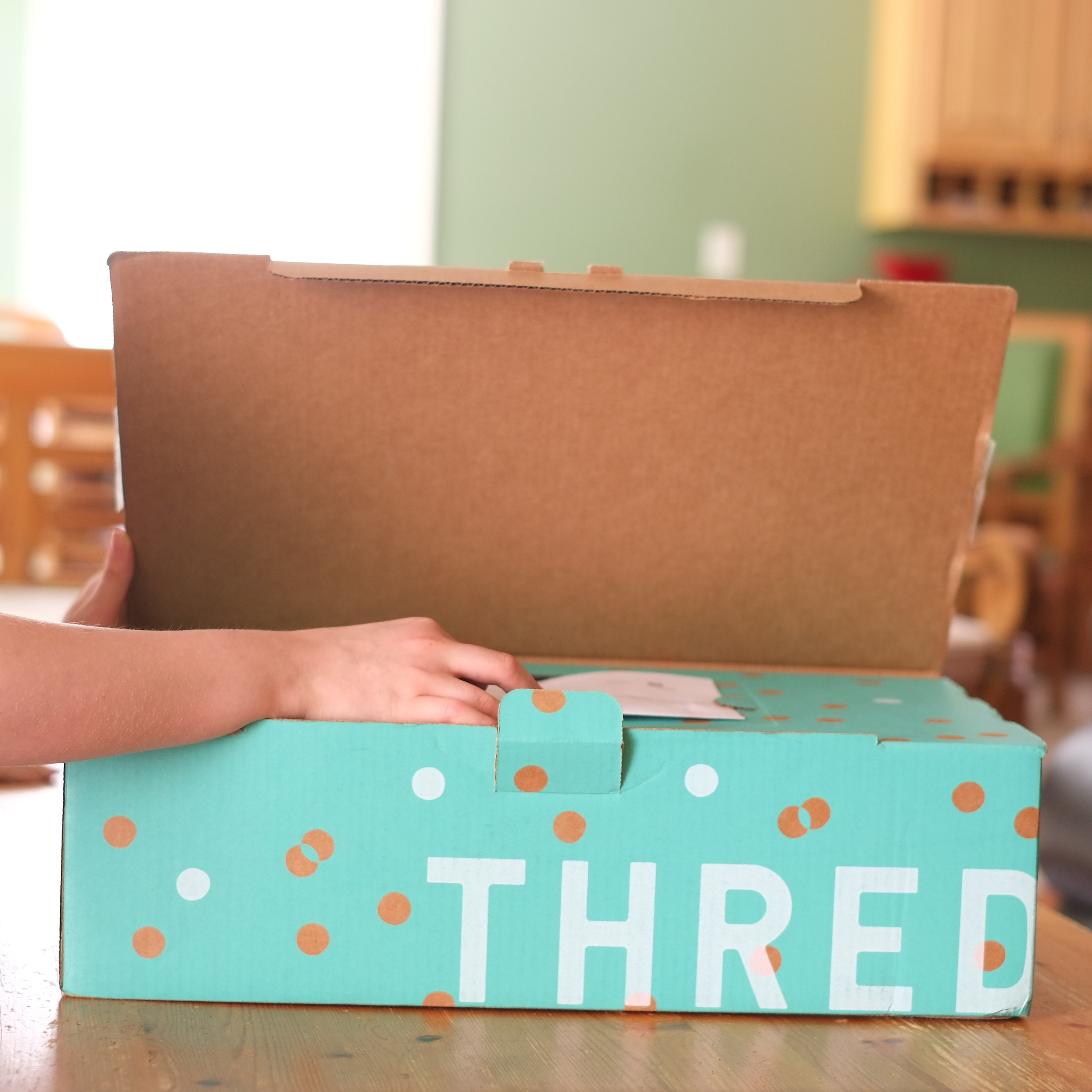 Unboxing our ThredUp clothing order