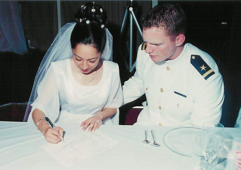 Franicia and me signing our marriage license in 2002. Yay! It's official!