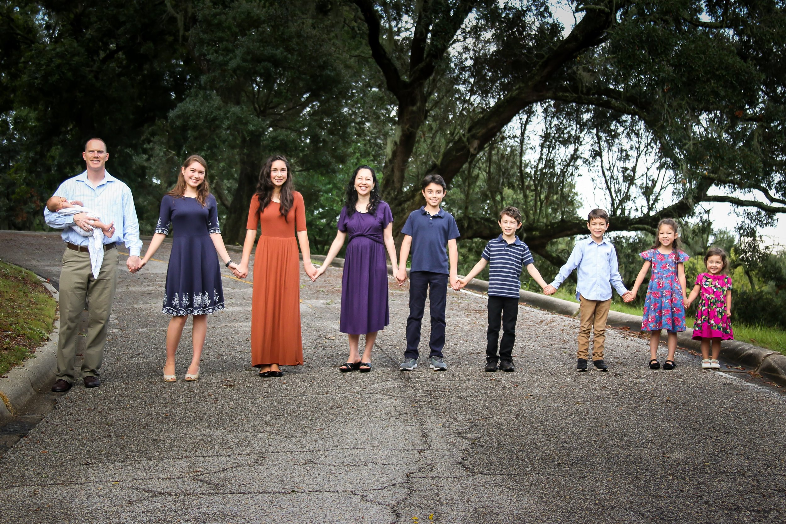 Tim and Franicia White and children at home in Pensacola, florida. Left to Right: baby gabriel, Tim, Heistheway, Pelaiah, Franicia, Abraham, Noah, Daniel, Shiloh, and priscilla. (Photography by america henry photography ) © 2018 tim & franicia