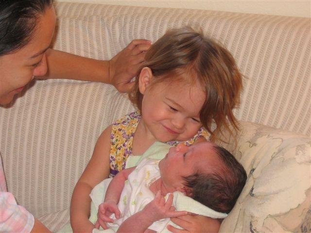 28APR05 043 - Franicia Heistheway holds baby Pelaiah nice.jpg