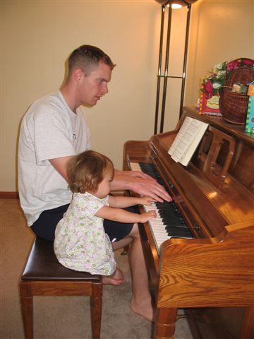 10JAN05 006 - Tim playing piano Daddy and Heistheway.jpg