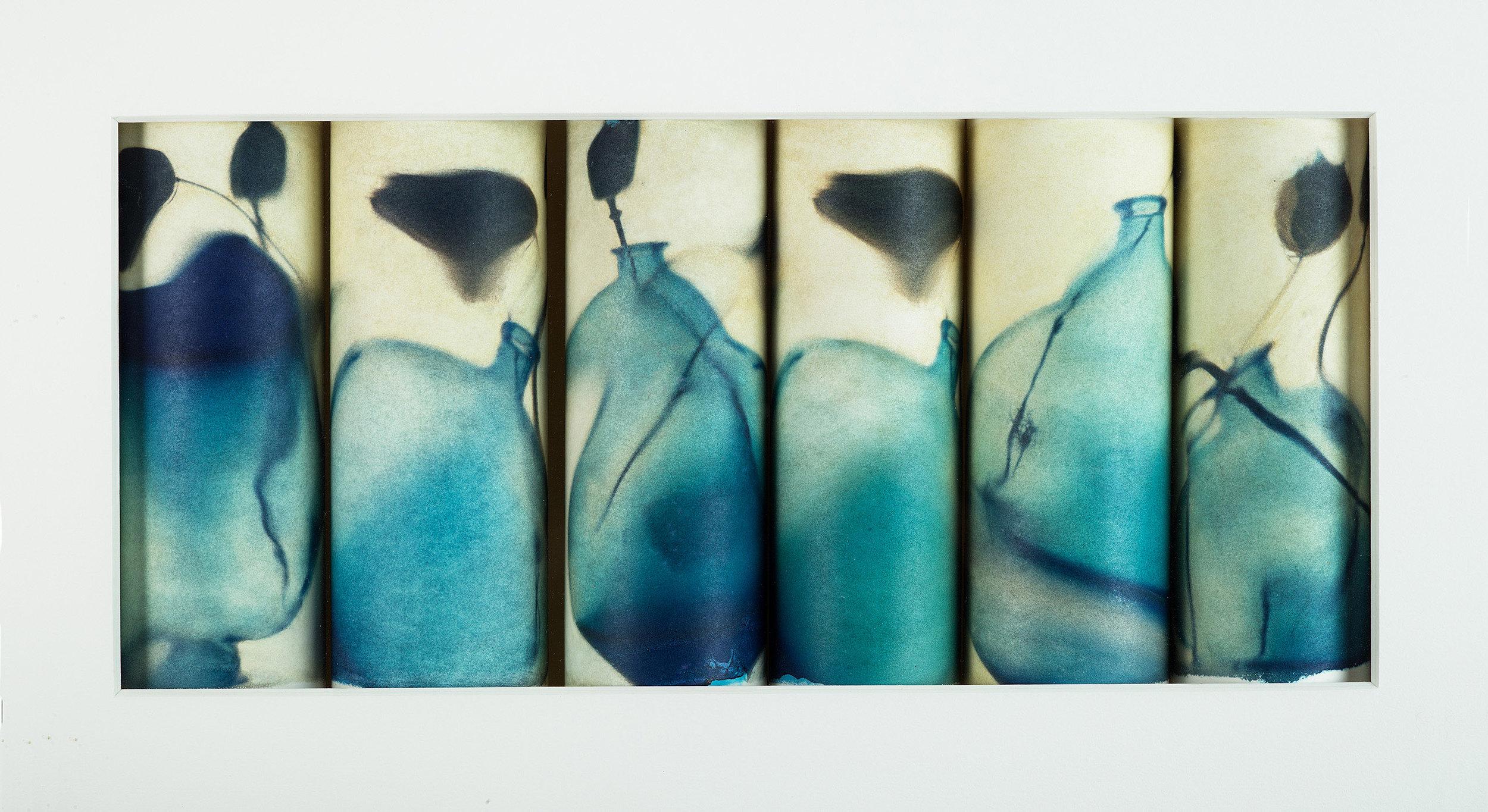 Rolled prints/Polaroid Transfers