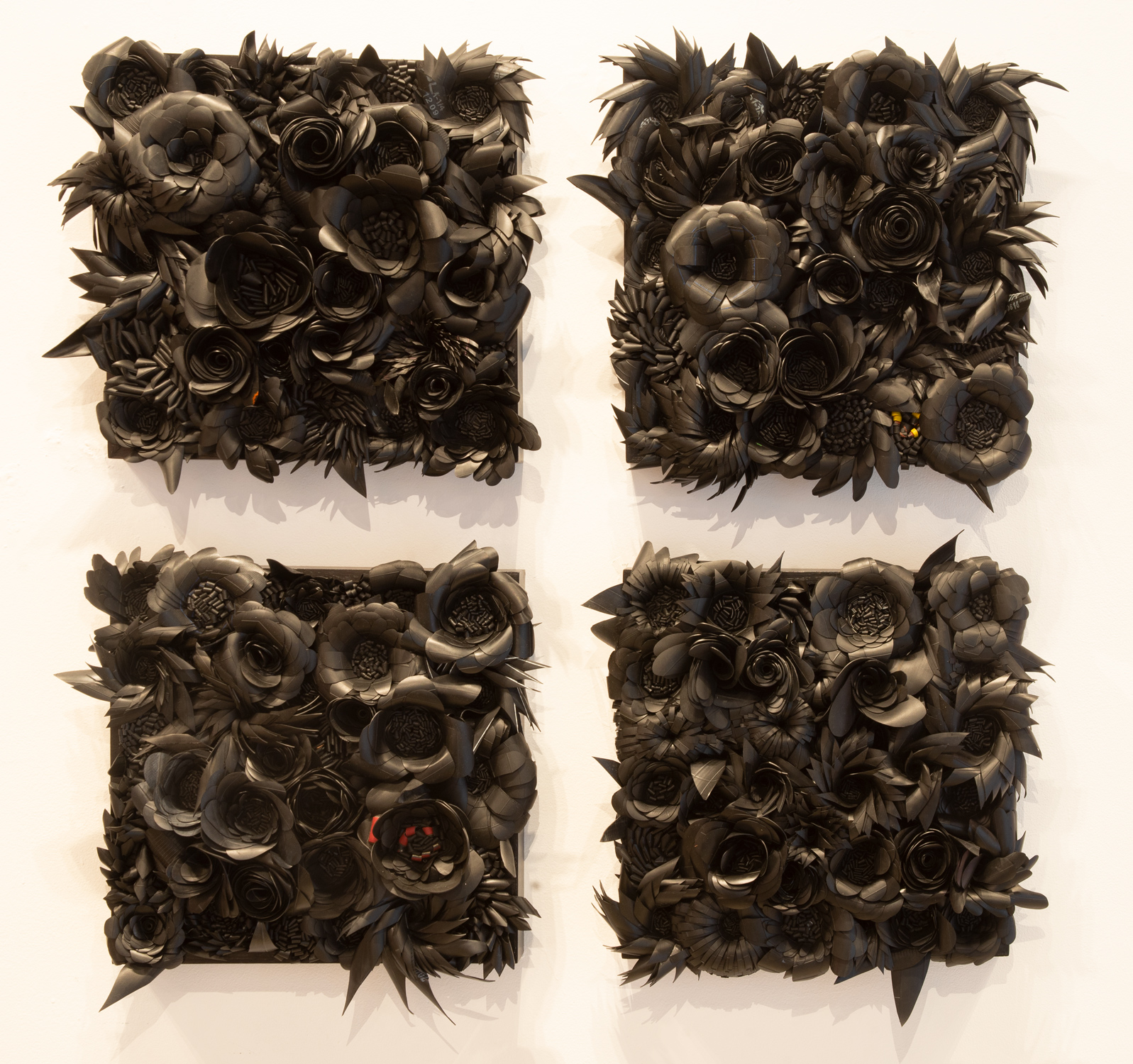 Ani Hoover  Rubber Gardens , 2019  Post-consumer bicycle tubes in a wood frame 30 × 30 in
