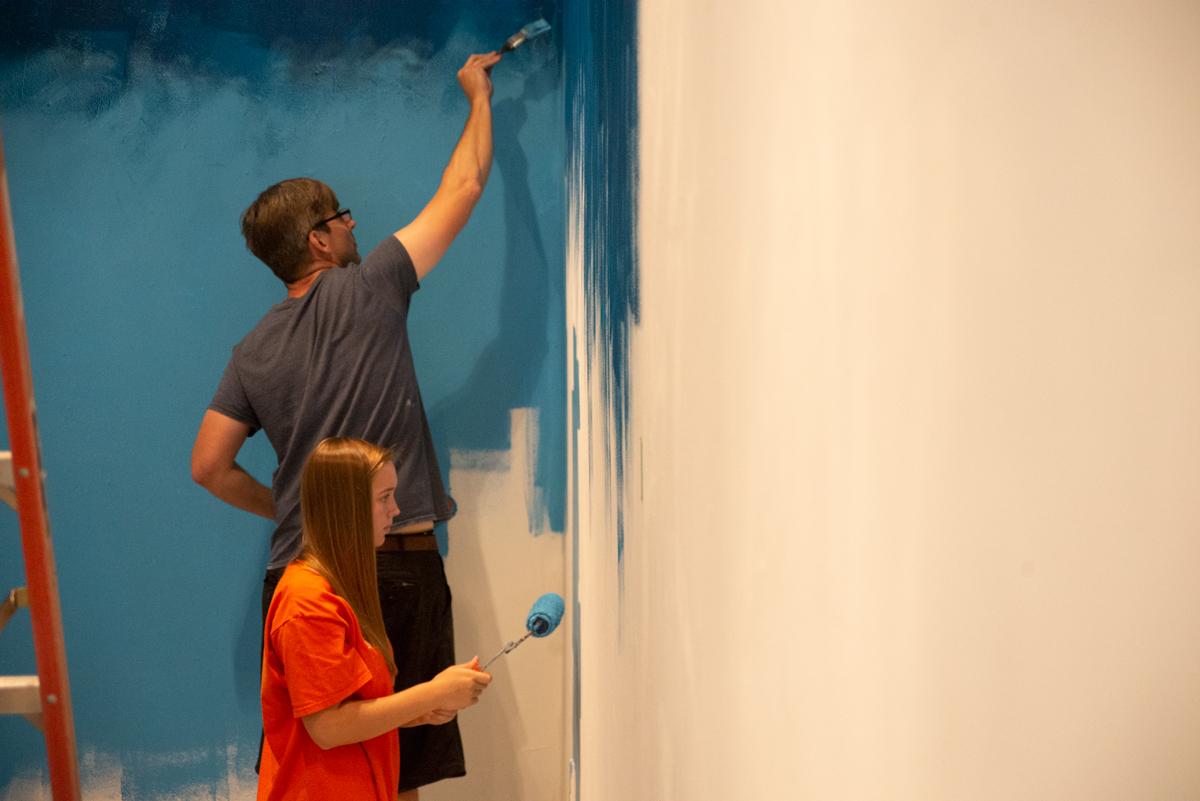 Matt Lively and Jane painting the studio