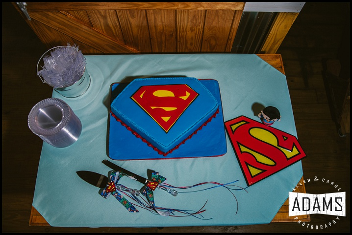 THE GROOM'S CAKE! WHY NOT SUPERMAN?! ONE OF THE COOLEST GROOM CAKES WE'VE SEEN.