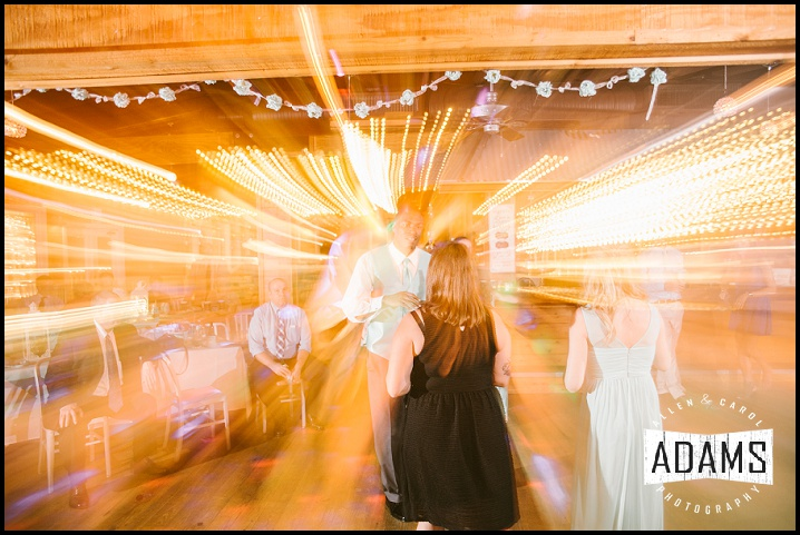 ALLEN HAS SO MUCH FUN PLAYING WITH THE LIGHTS AT RECEPTIONS. HAD TO INCLUDE THIS SUPER COOL SHOT!