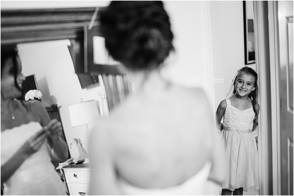 "We sometimes plan this ""moment"" but didn't need to this time.  The sweet flower girl peeked in on the Bride (also her soon to be step-mom) and was just delighted! How precious is this?"