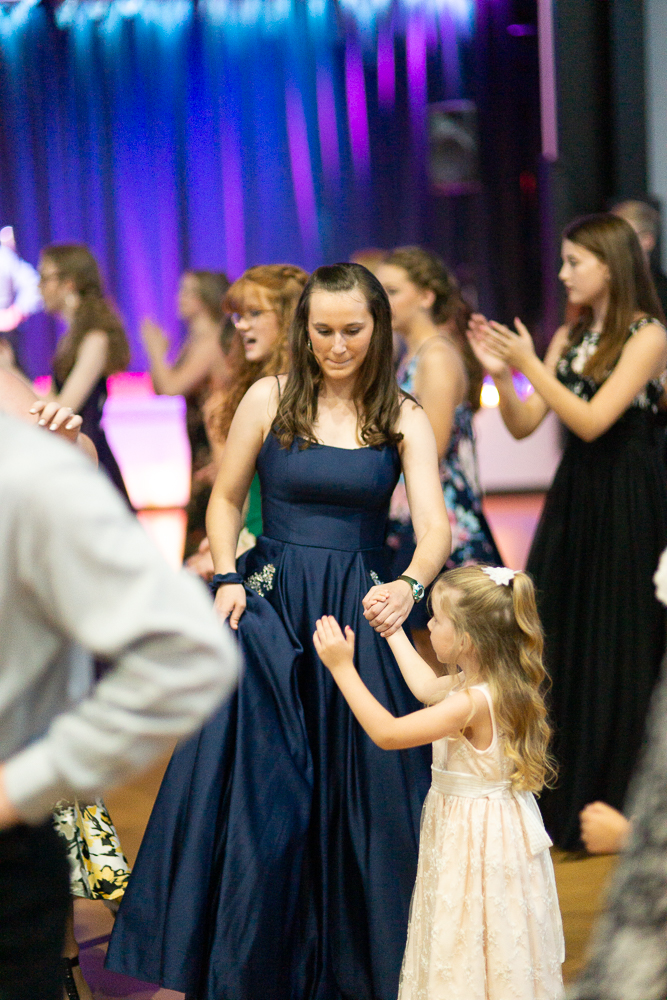 From as far back as I can remember, Hope has always had a little kid hanging onto her.  She is such a kid magnet and has a gift with them.  So why should this night be any different? Ha-ha.  Also one of the reasons I love these dances….they are multi-generational!
