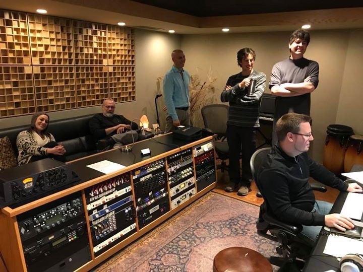 The band listening to tracks for the Jane Kramer album. Adam Johnson, producer/engineer.