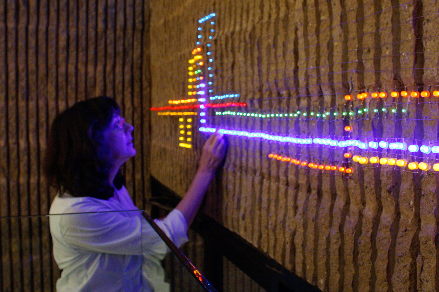 Salmanson creating her LED light installation,  Step Lightly,  at the Visual Arts Center of NJ