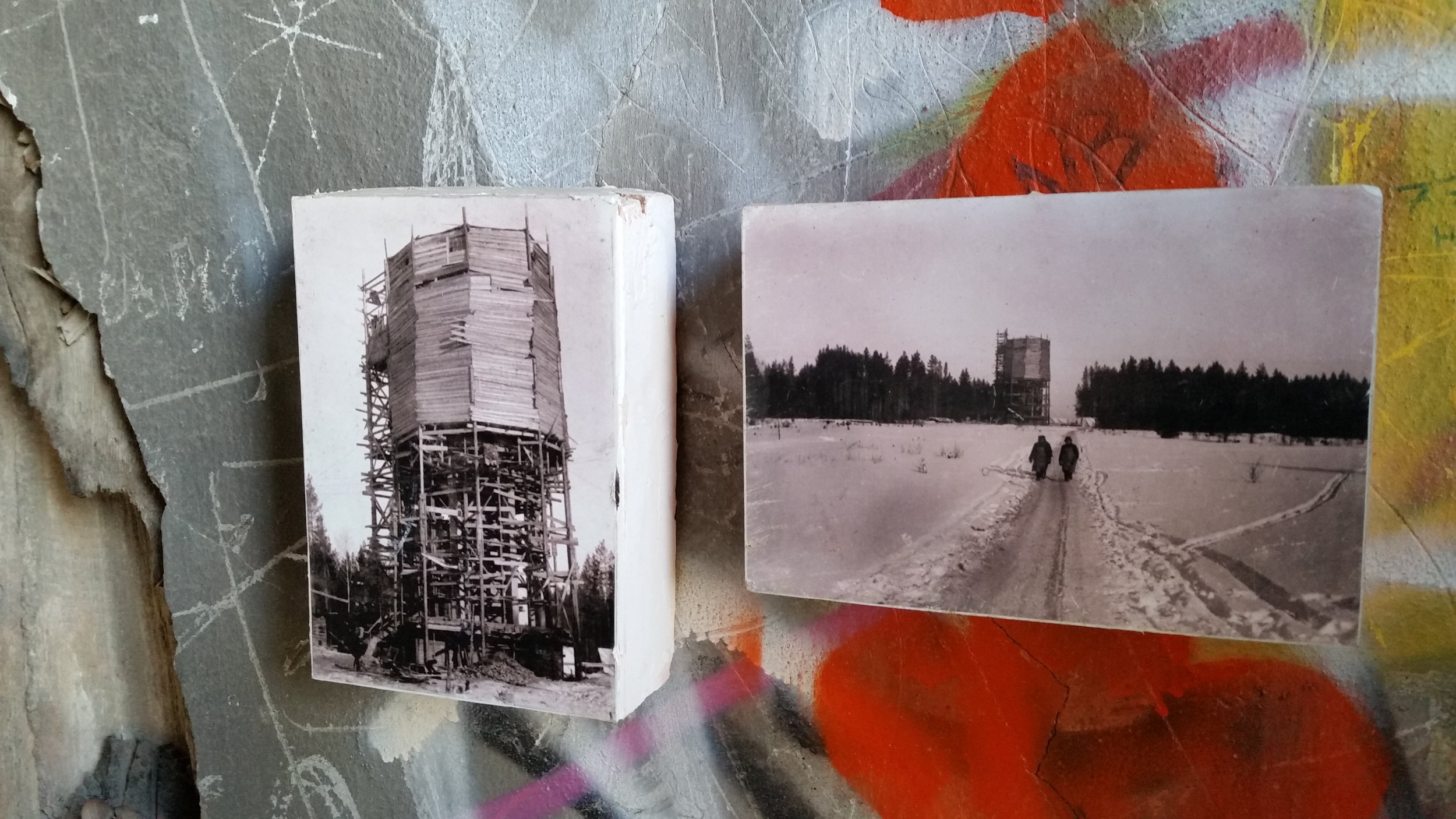 The architects who are working to restore the tower found old photographs of its construction and hung them on the graffiti-coveraed walls.