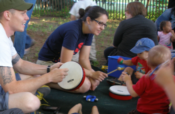 Children and their families making music together