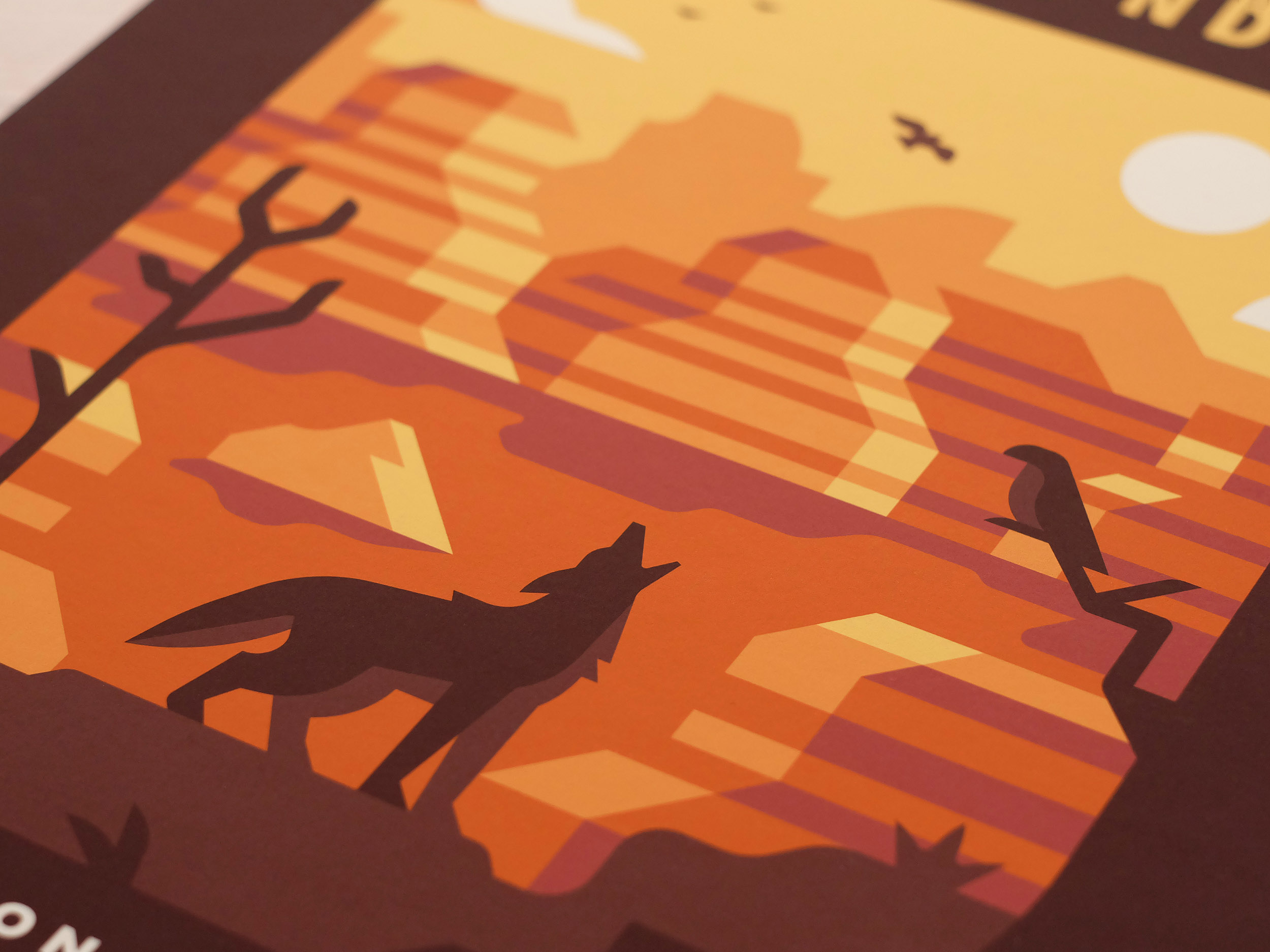 Badlands National Park poster photo by Matt Anderson and Canopy Design. Limited color illustration of a desert canyon, bird, trees and a coyote.