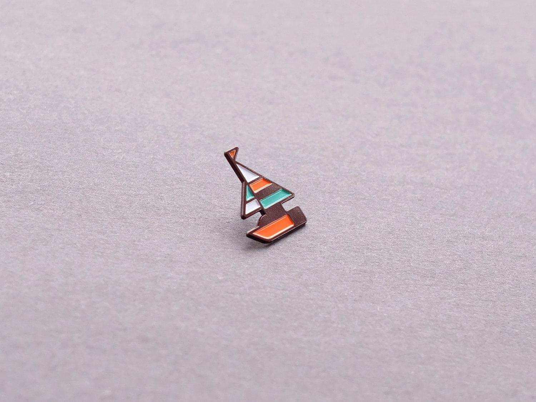 Matt Anderson geometric sailboat enamel pin.