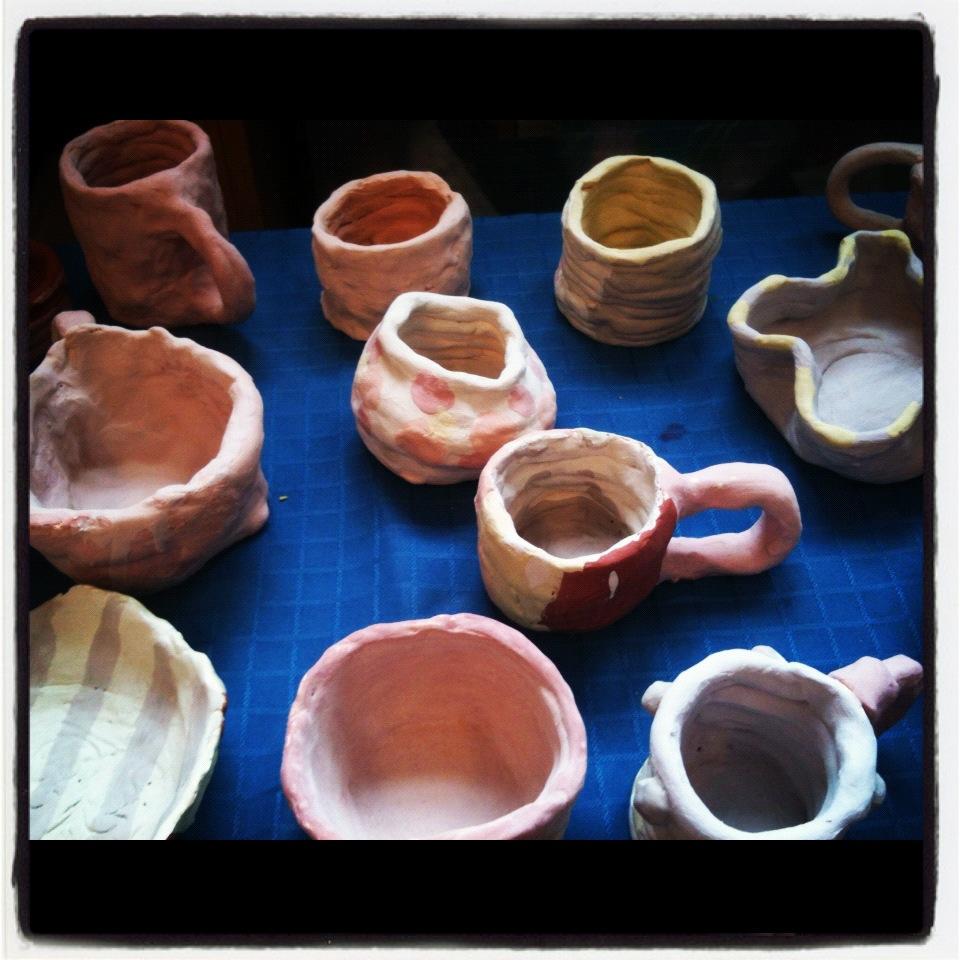 Freshly glazed Father's Day mugs! Artist; Grade 5