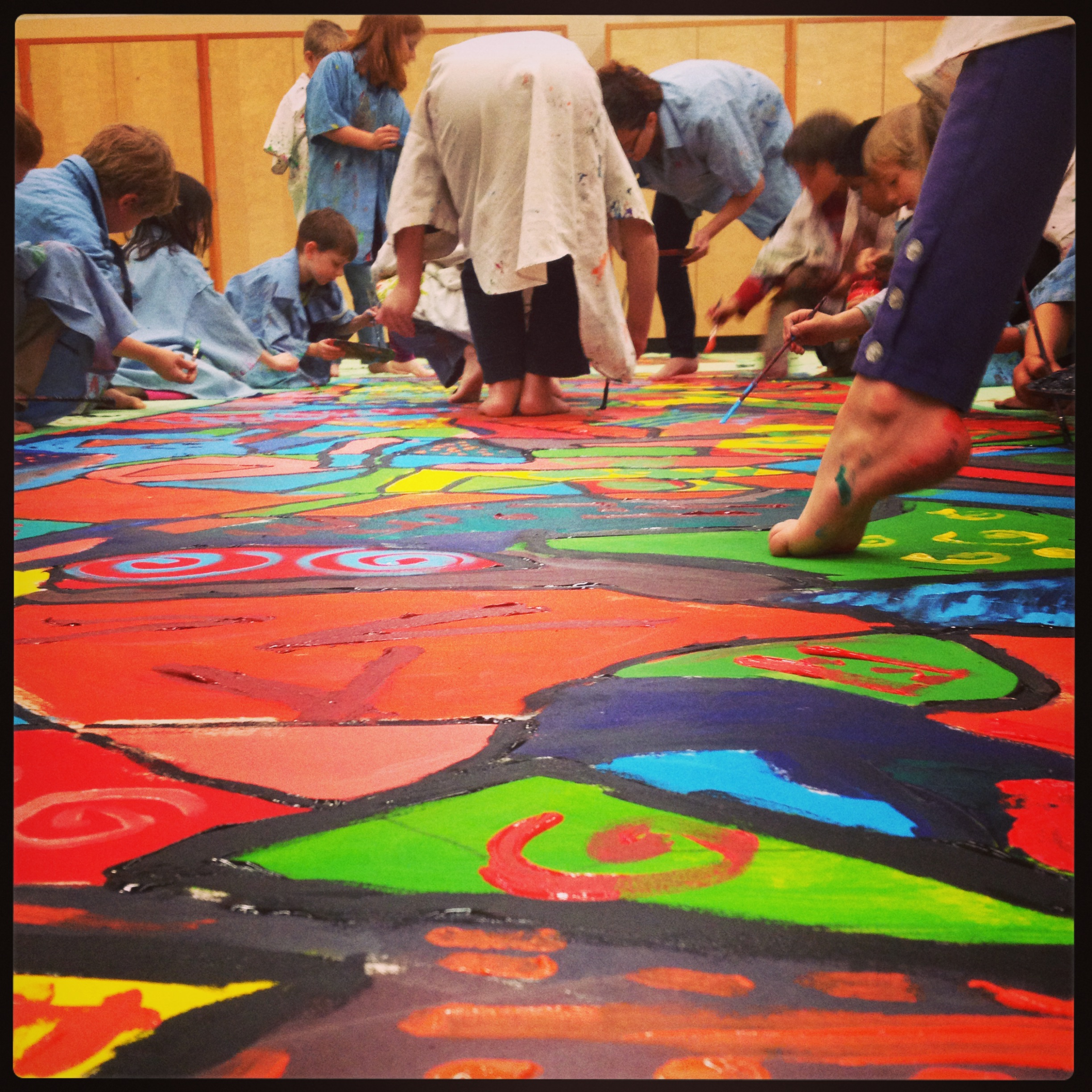 This huge canvas was painted using the children themselves as templates for abstraction. We learned about colour and pattern, collaboration and community. After hanging in the hallway for a short time, the mural was divided and mounted onto boards so that each child could take home a piece of the creation.