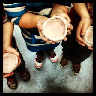 Freshly glazed pinch pots created by kindergardeners!