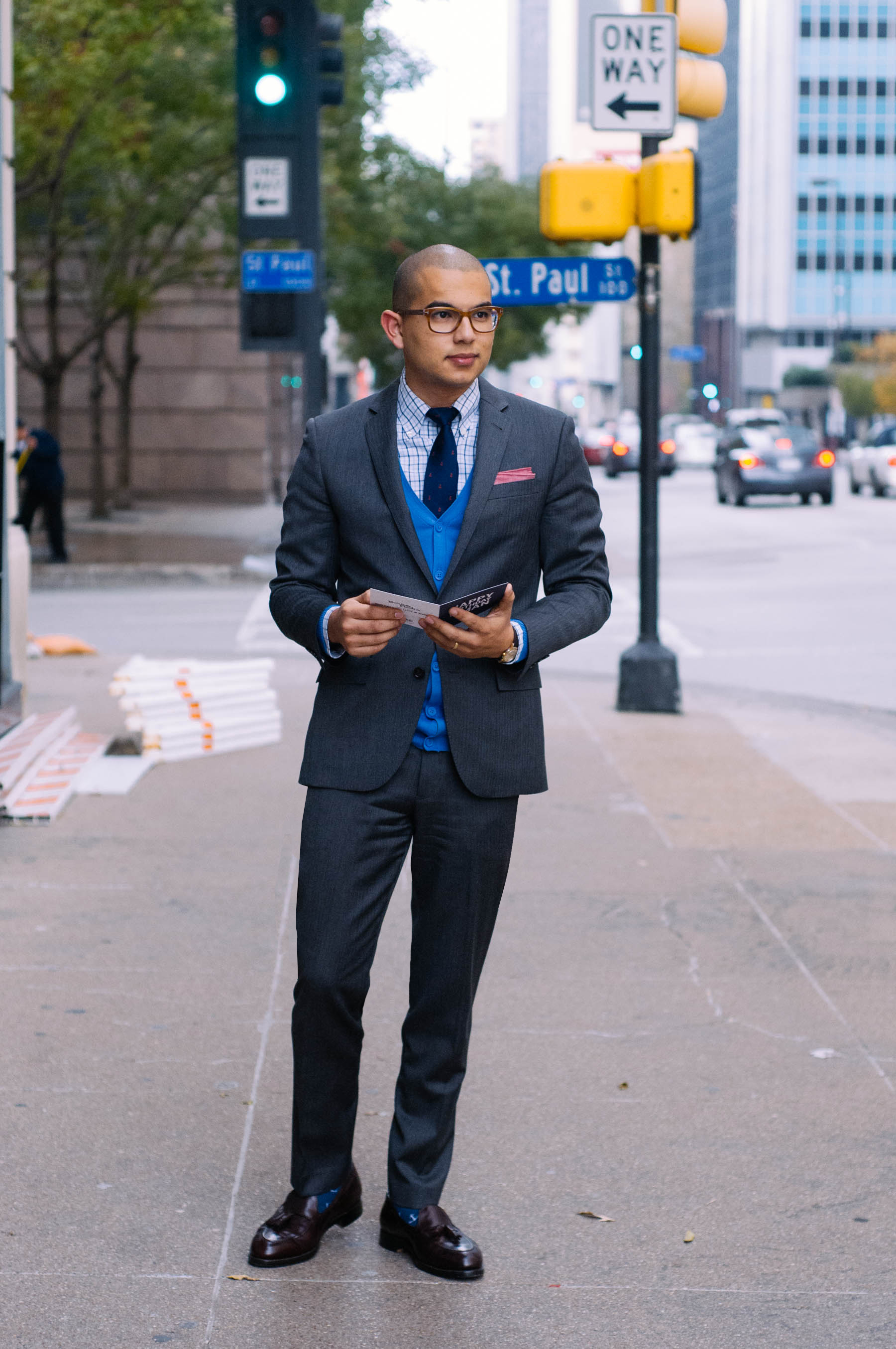 Suit: J.Crew | Shirt: Brooks Brothers | Sweater: H&M | Shoes: Alden | Socks: J.Crew | Tie: J.Crew | Pocket Square: The Tie Bar | Watch: Omega | Glasses: Tom Ford