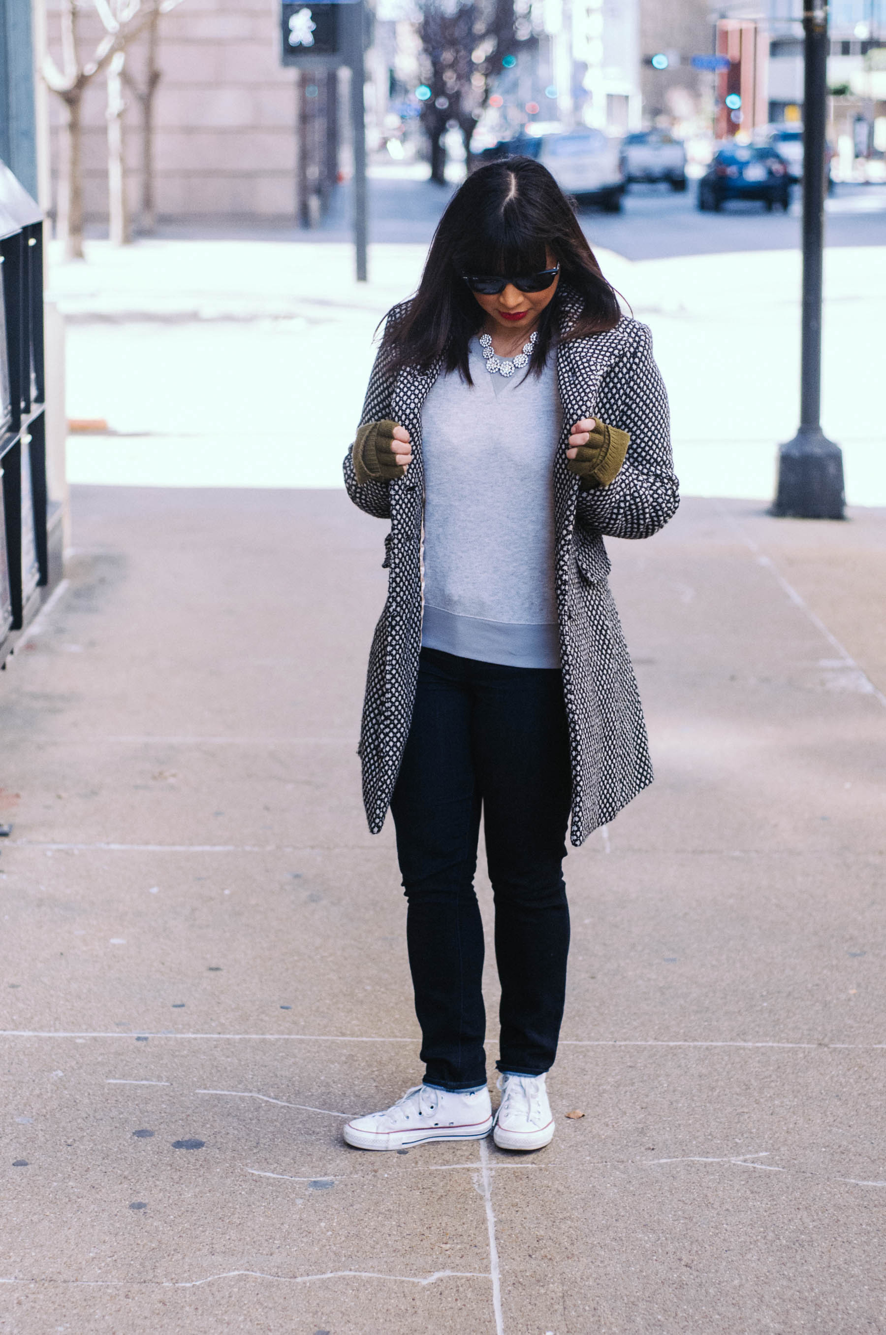 Coat: Coffeeshop NYC (similar  here )   Sweater:  Mossimo    Jeans:  Madewell    Sneakers:  Converse    Gloves: J.Crew (similar  here )   Necklace: Forever 21   Sunglasses:  RayBan
