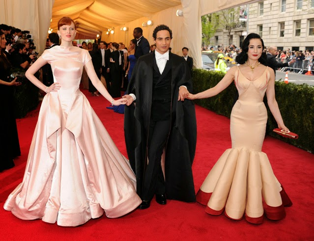 He may look like a Renaissance Chancellor, but Posen will always overshoot a dress code, than underdress. Dita VonTeese's gown is his modern take on James' famous  Clover Gown designed for Augustine Hearst in the 1950's.