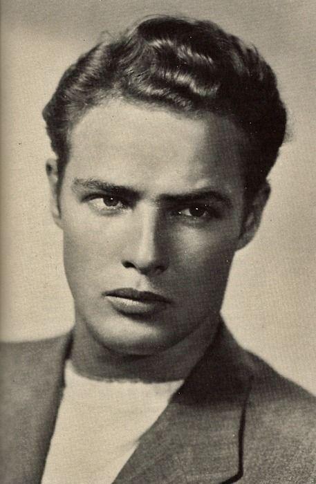Young Brando looking quite collegiate in a sweater/blazer look.