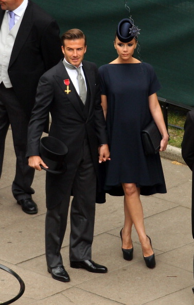 Pregnant and chic at the Royal Wedding in her own design... and again... him...