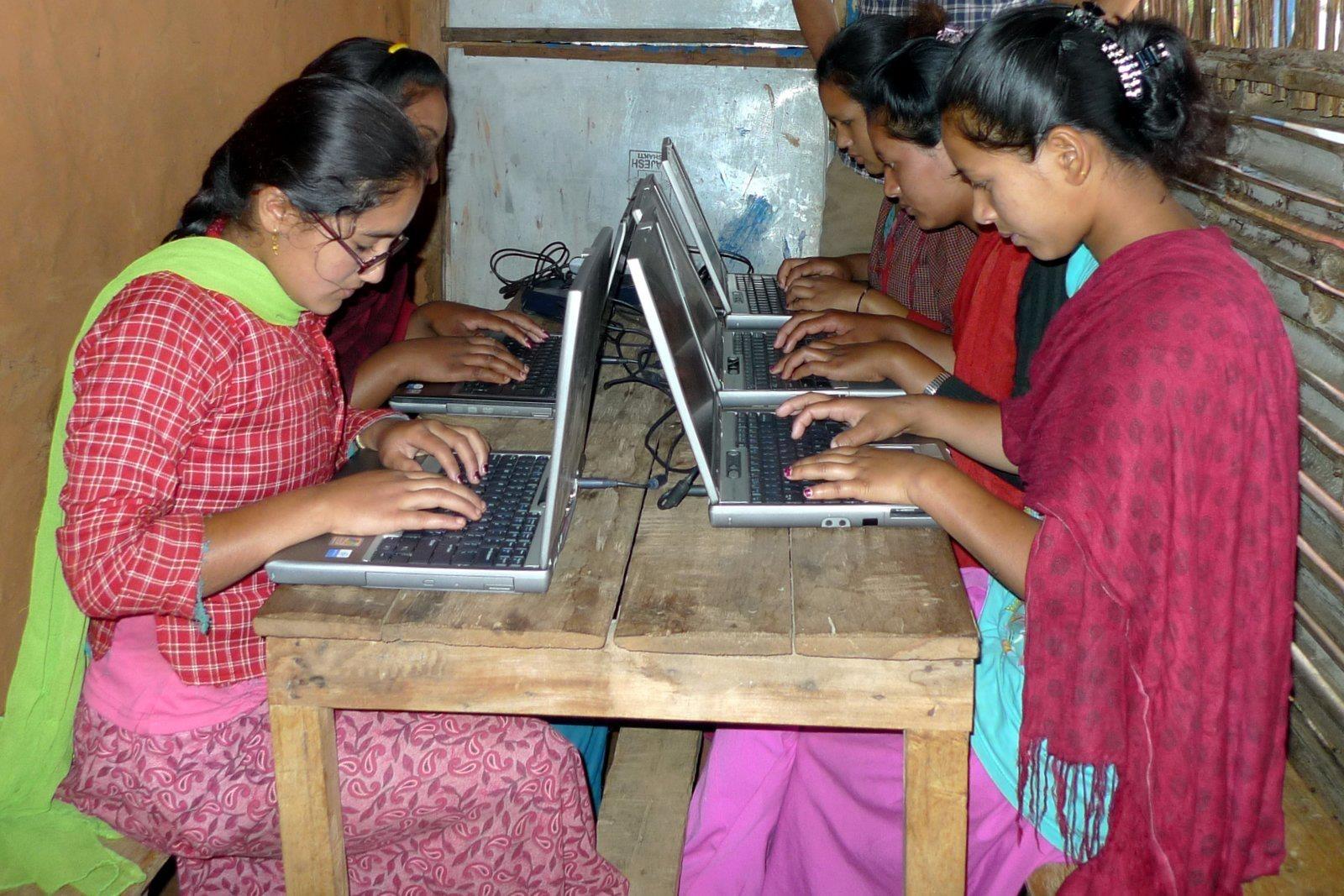 Village girls in after school computer training