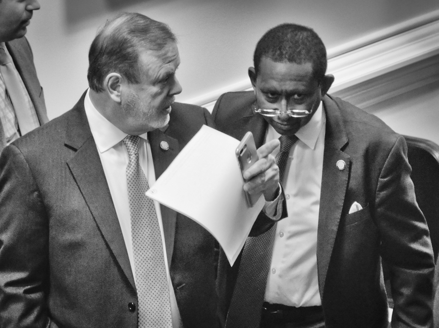 Sen. Phil Berger (left) talks with Sen. Floyd McKissick before debate begins in the Senate on the redistricting plan.