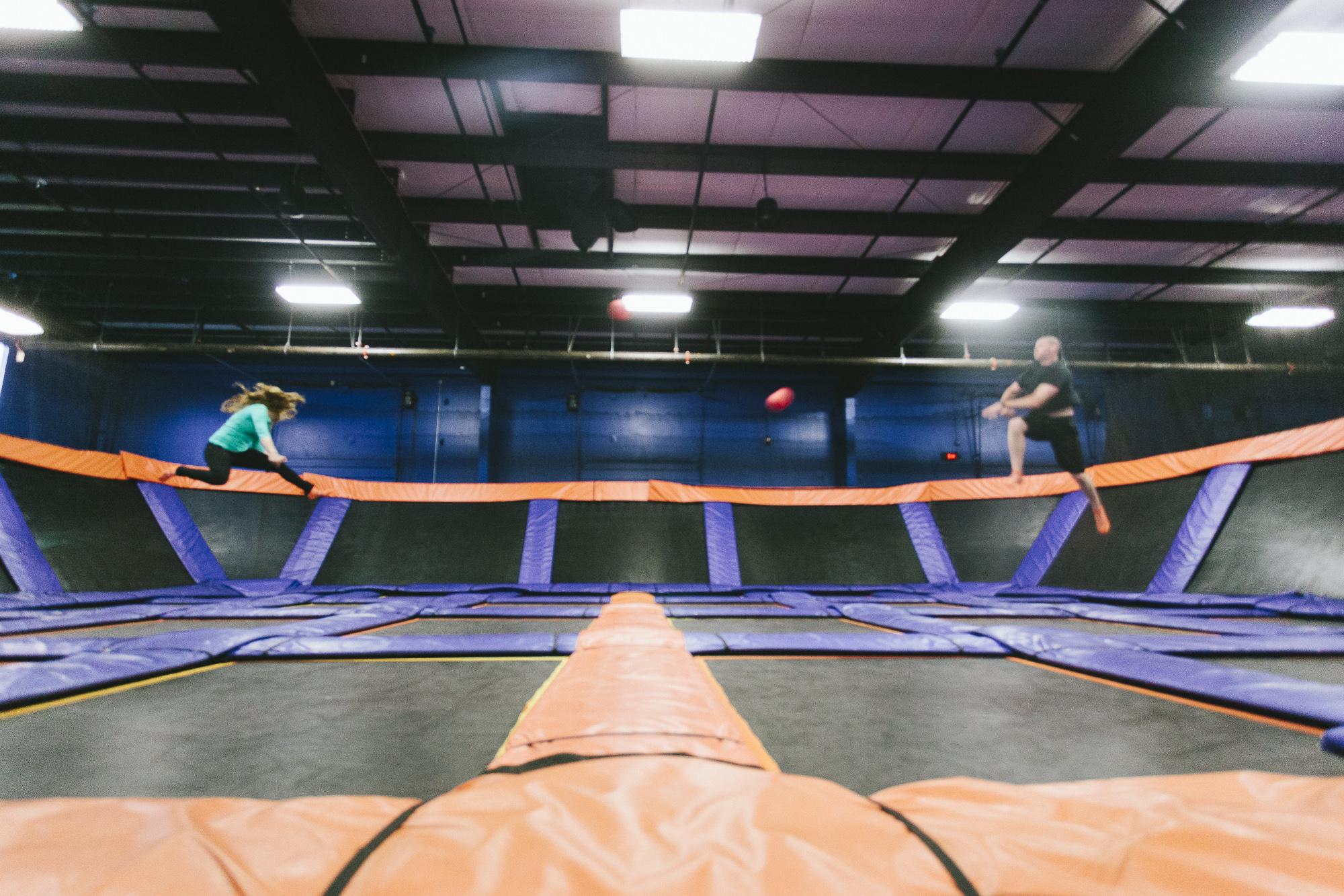 flying dodgeball trampoline couple