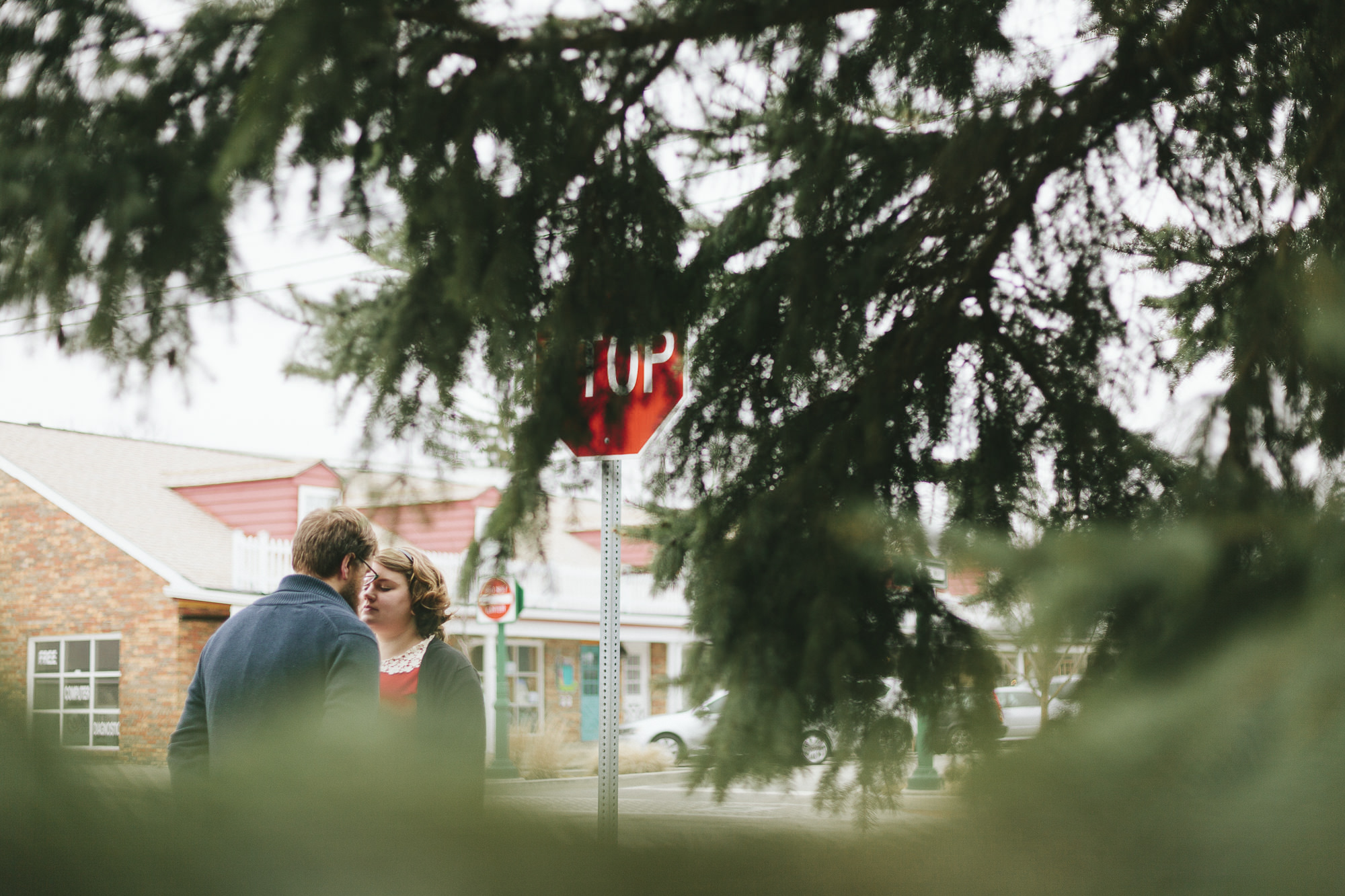 Retro couple kissing in trees