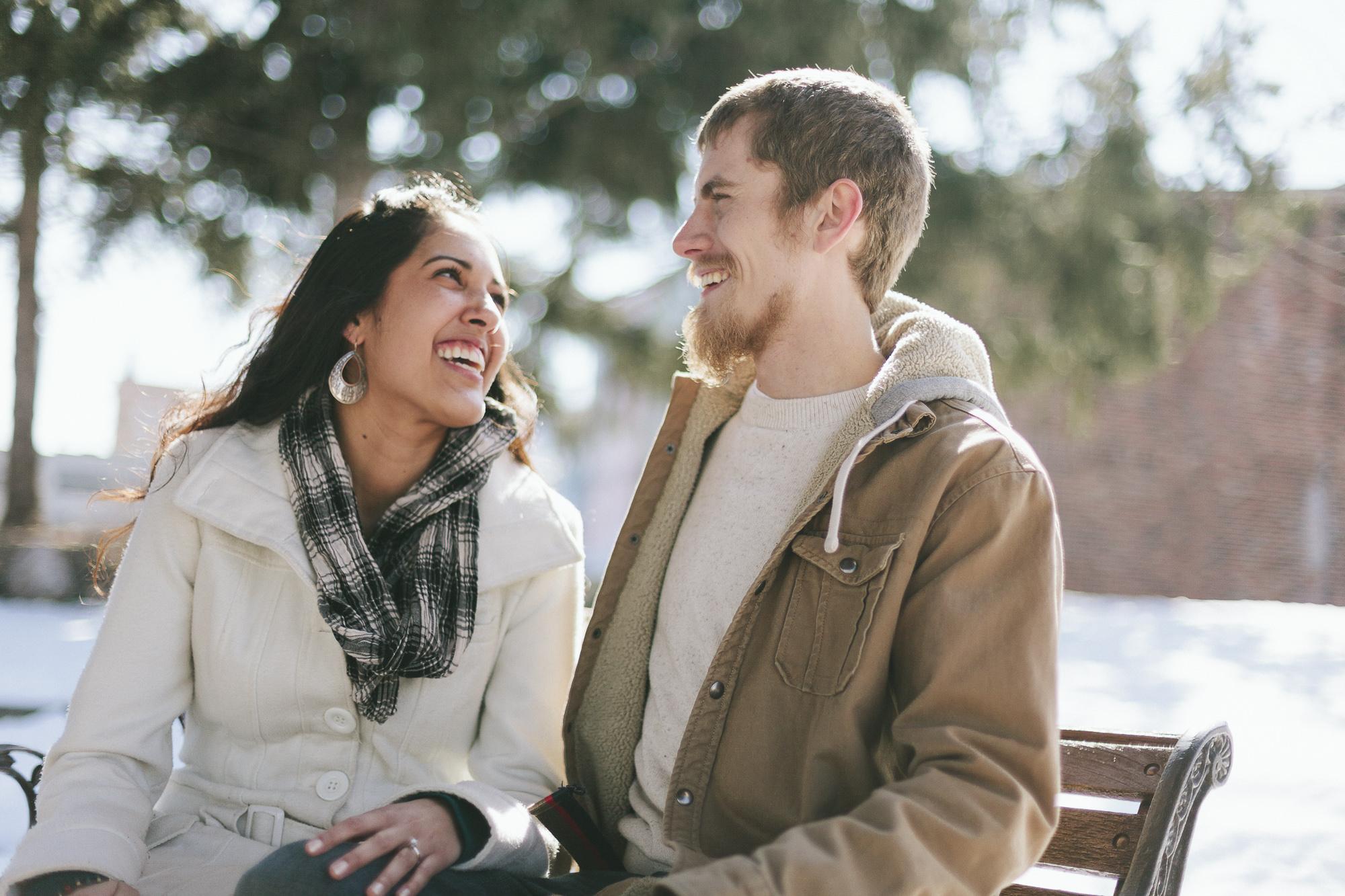 snowy couple laugh park