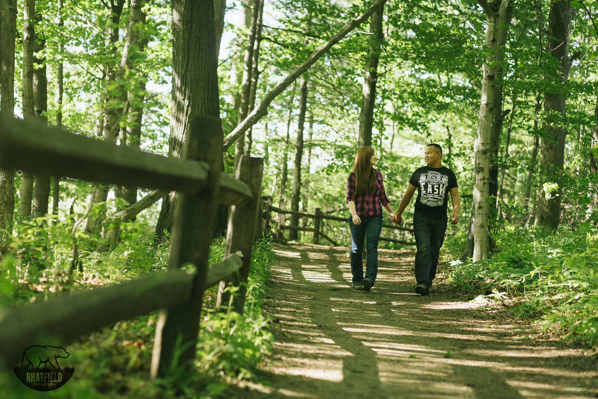 couple-walking-trail-woods