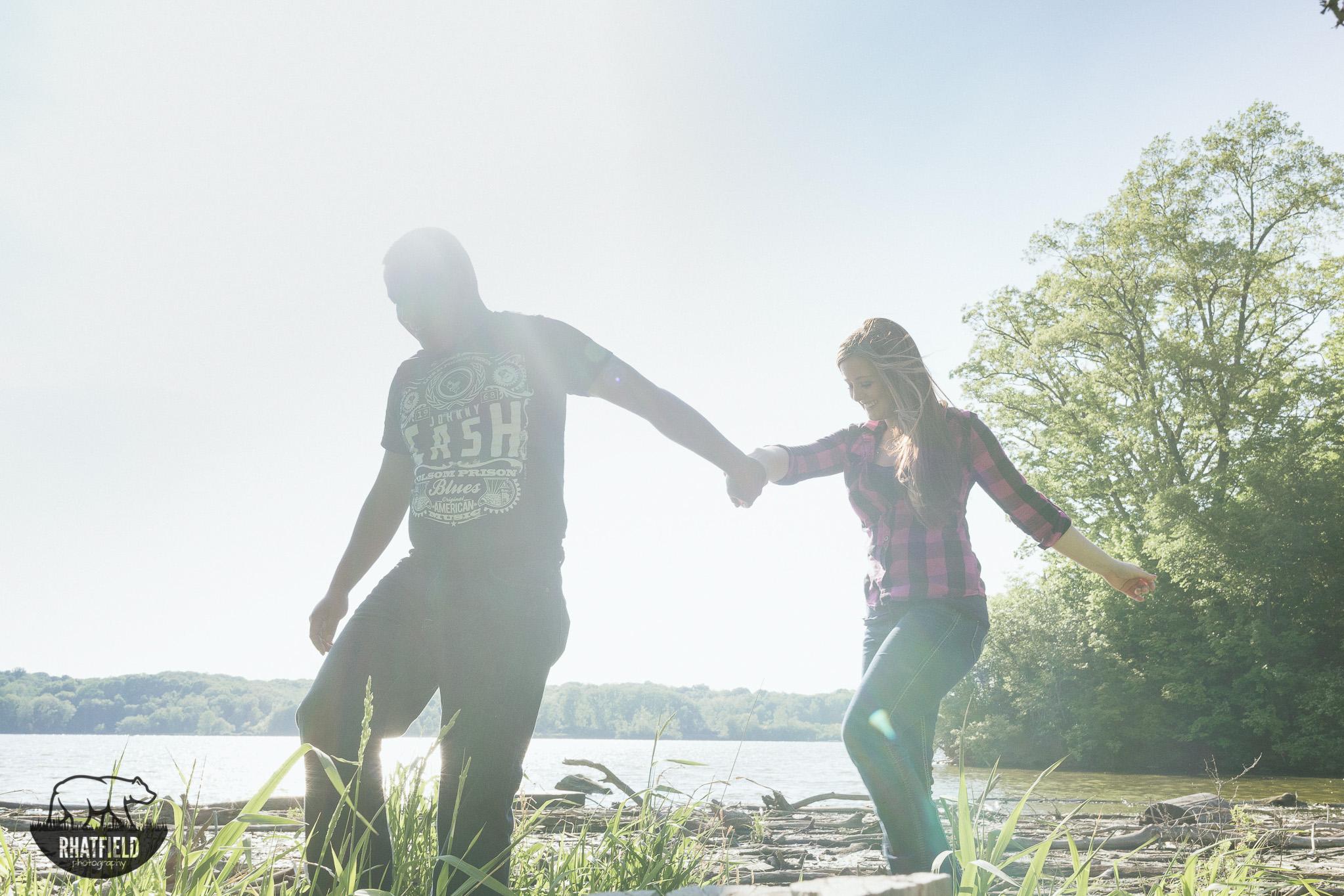 engaged-couple-walking-threw-marsh