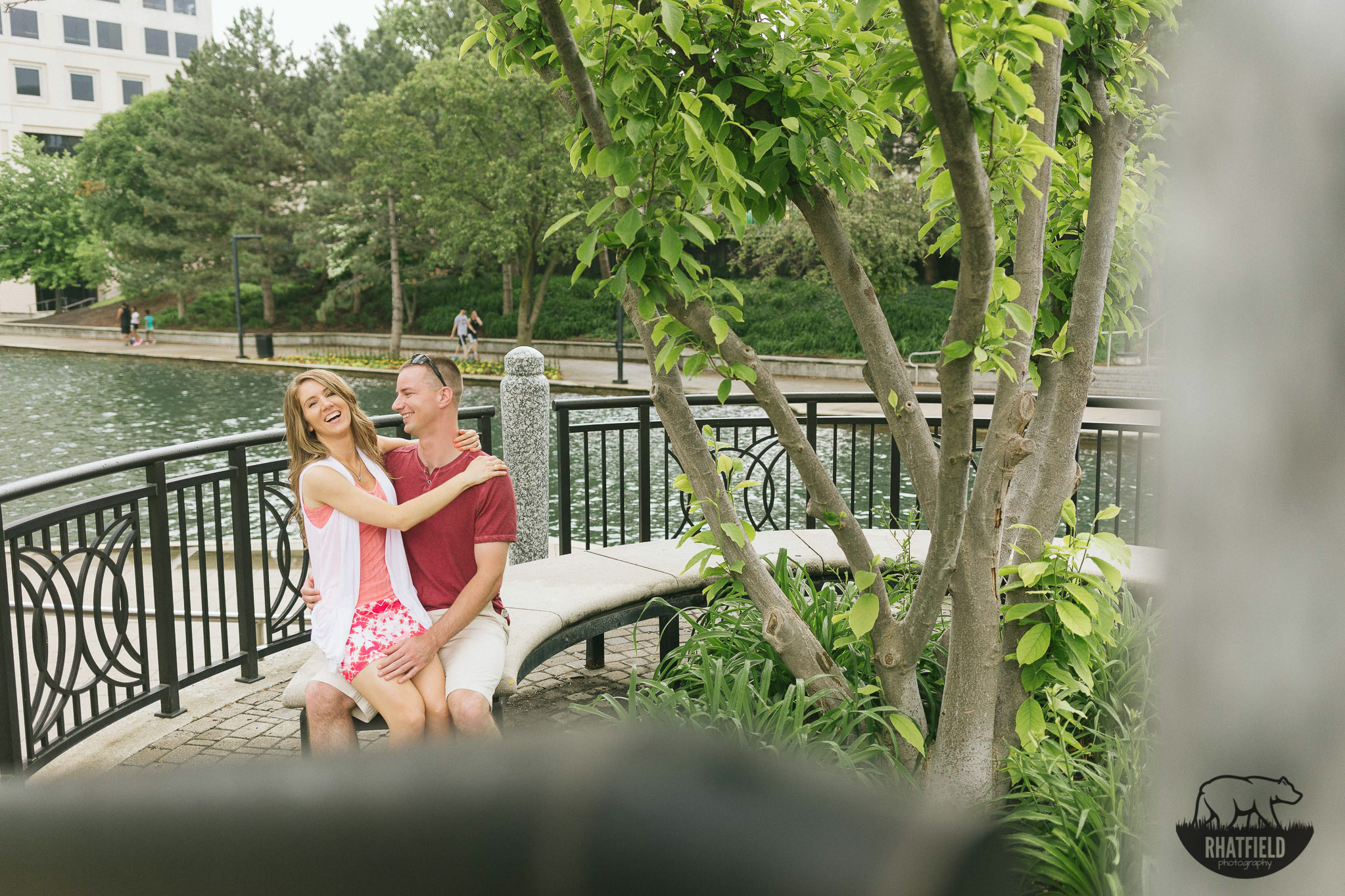 engaged-couple-laughing-on-bench