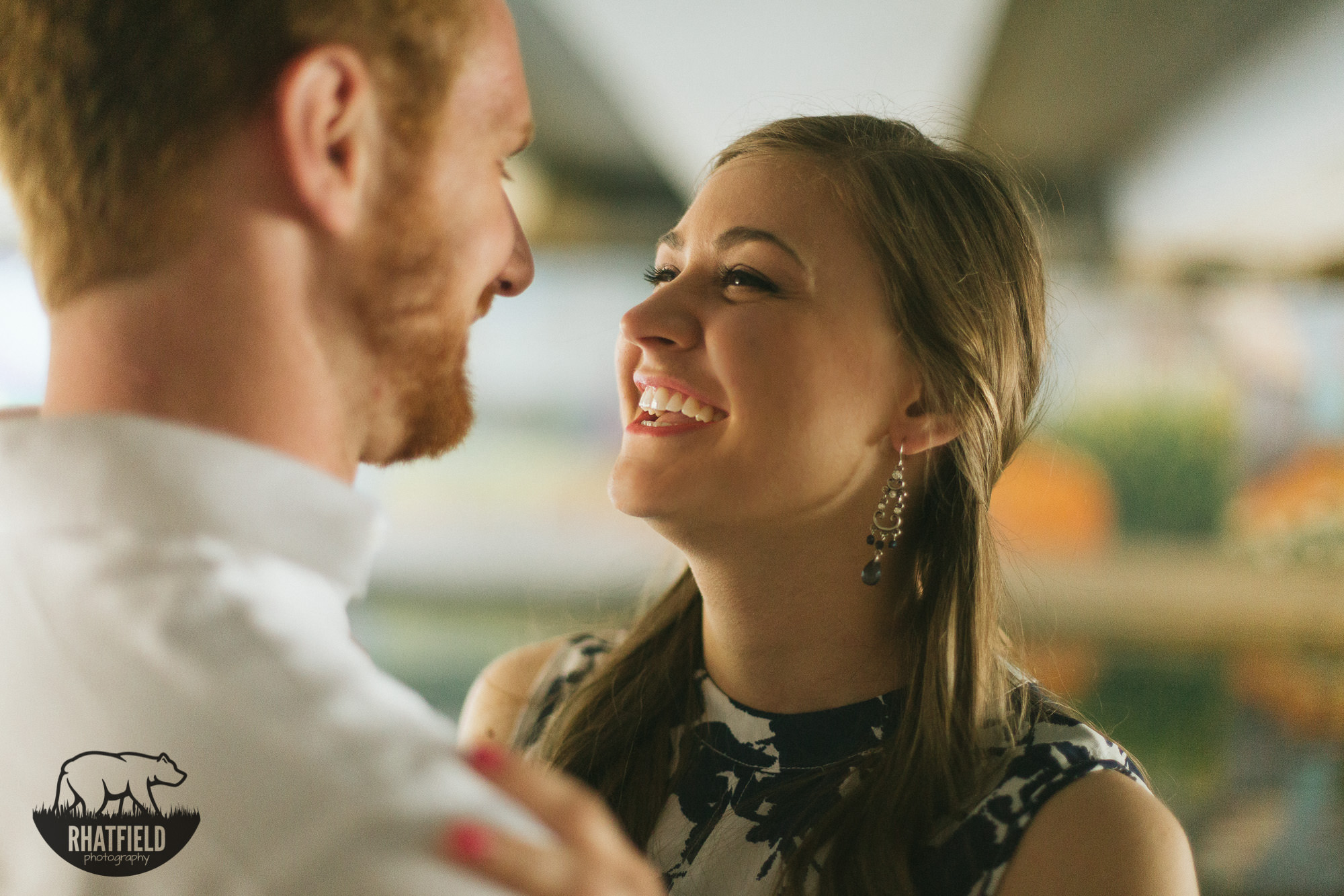 engaged-couple-laughing-close-together