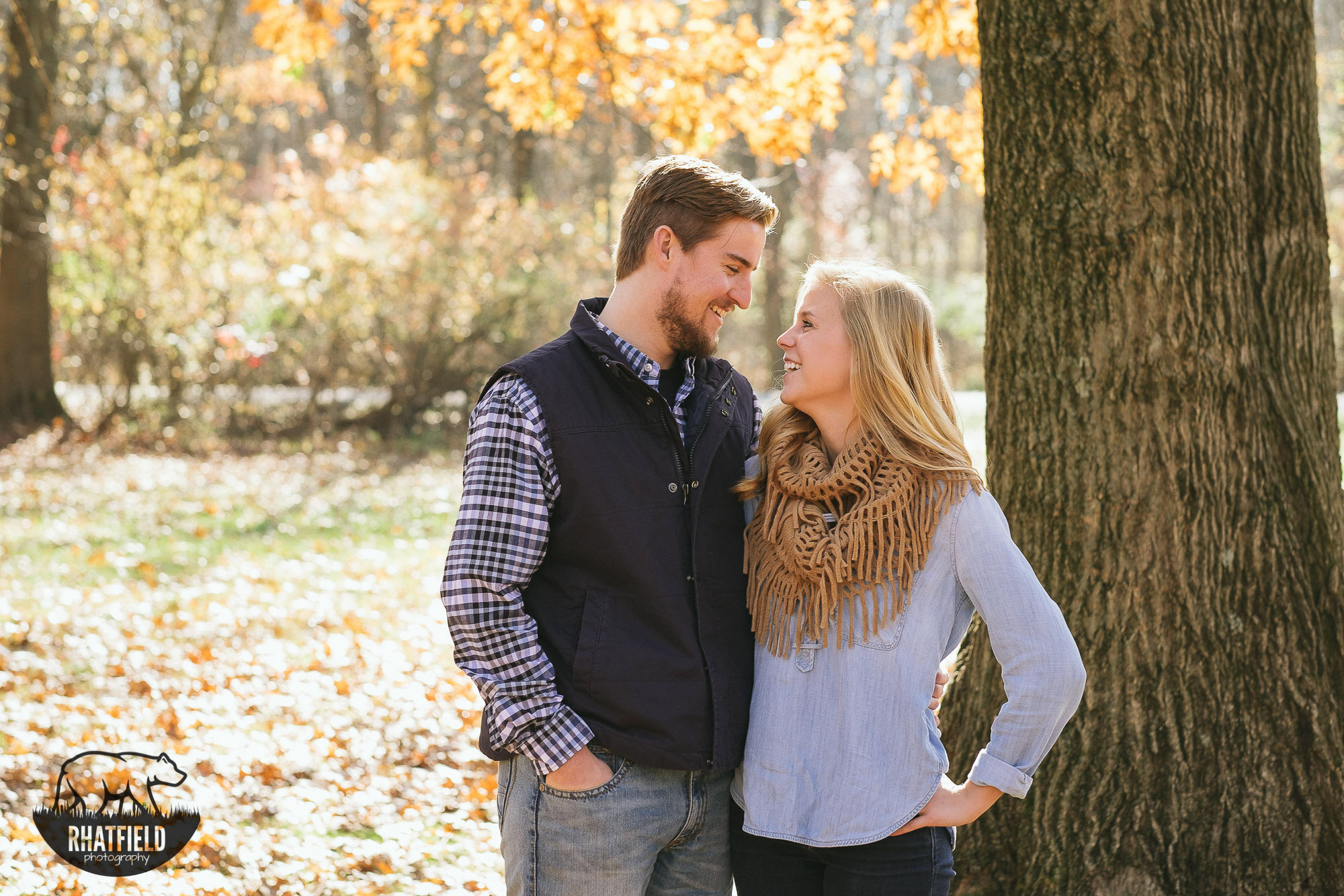 couple-laughing-fall-trees