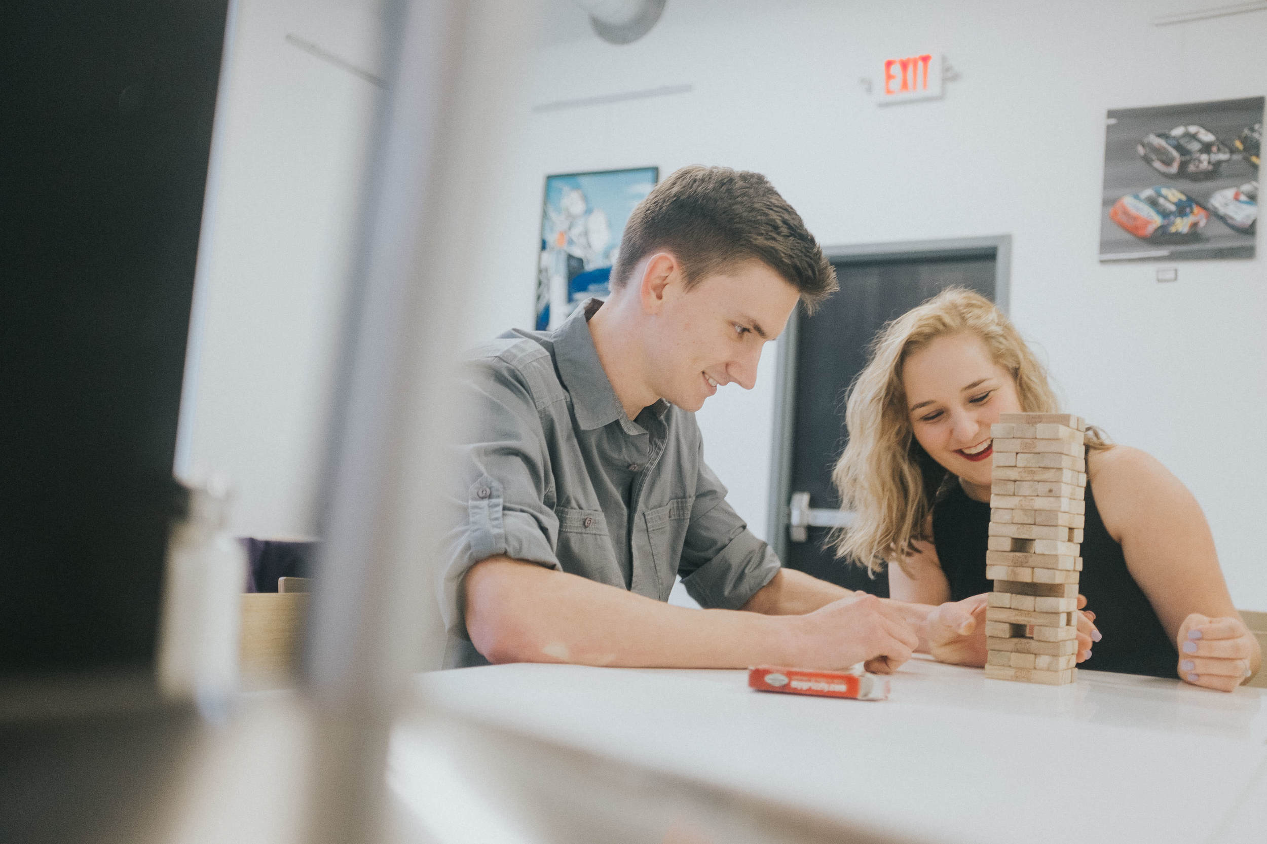 couple-laughing-playing-table-games
