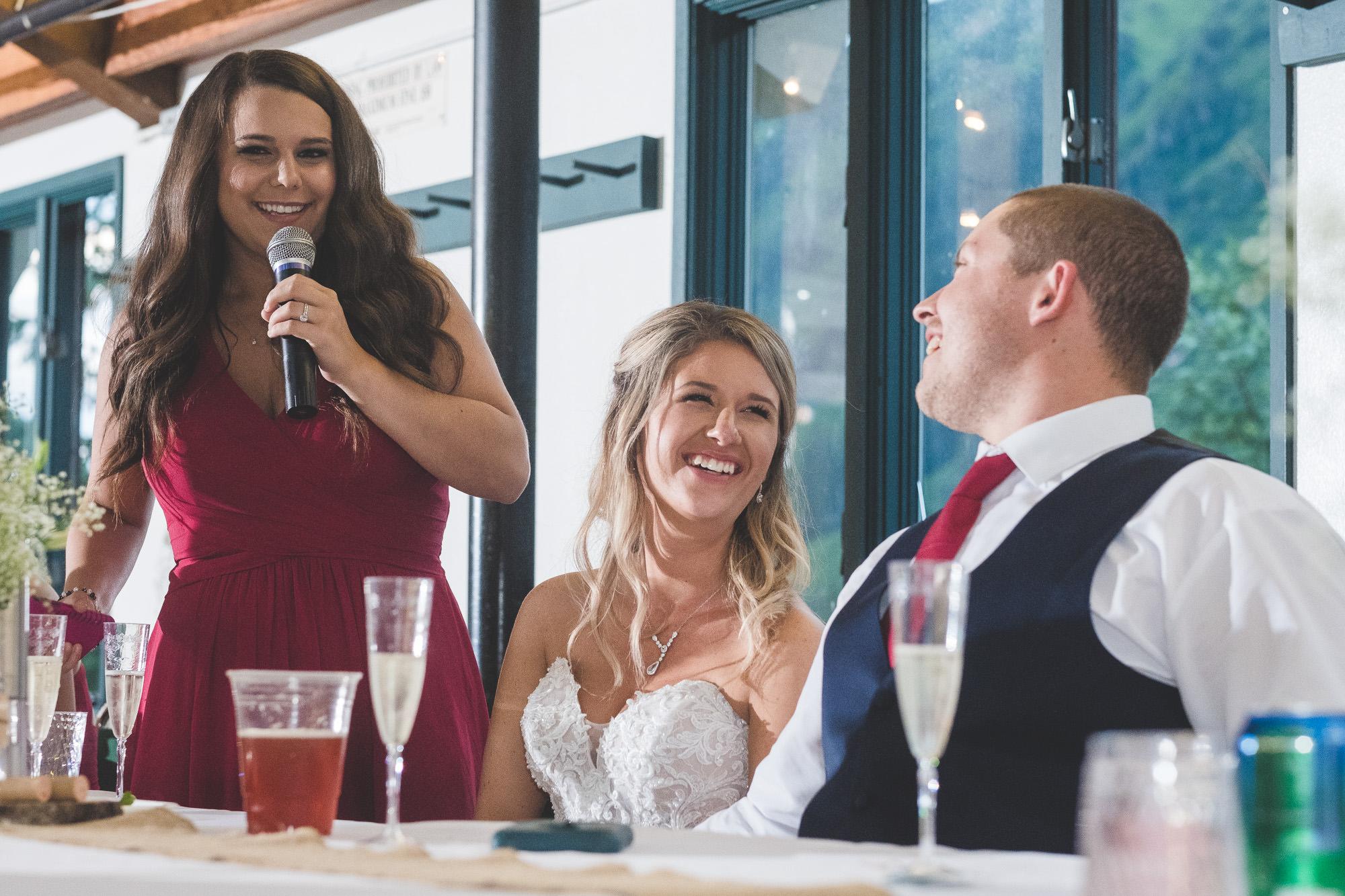 bridesmaid-speech-couple-laughing