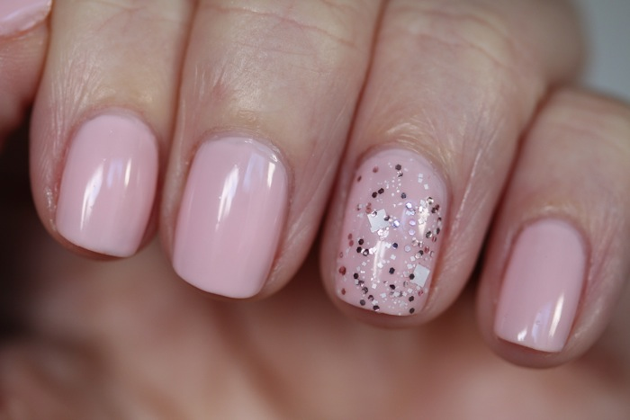 OPI's I love Applause (Pink Creme) and Let's Do Anything We Want (Pink and White Glitter)
