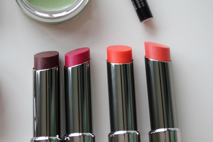 Mary Kay True Dimensions Lipsticks from left to right in Berry A La Mode, Sassy Fuchsia, Citrus Flirt and Tangerine Pop