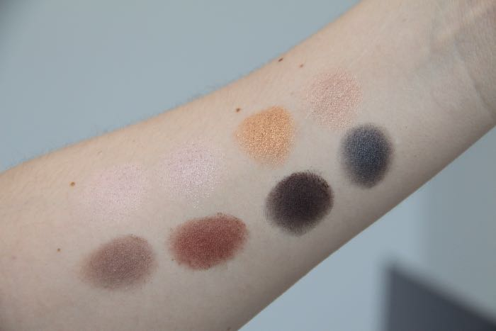 Pro Palette swatches from left to right starting on the top row: Nude, Champagne, Gold, Light Bronze, Pewter, Garnet, Deep Purple and Slate