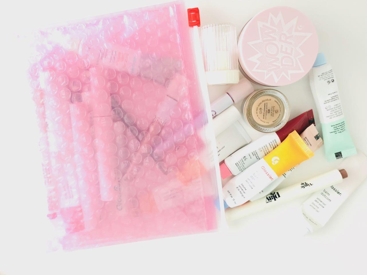 All the Glossier stuffed inside a pink bubblewrap pouch