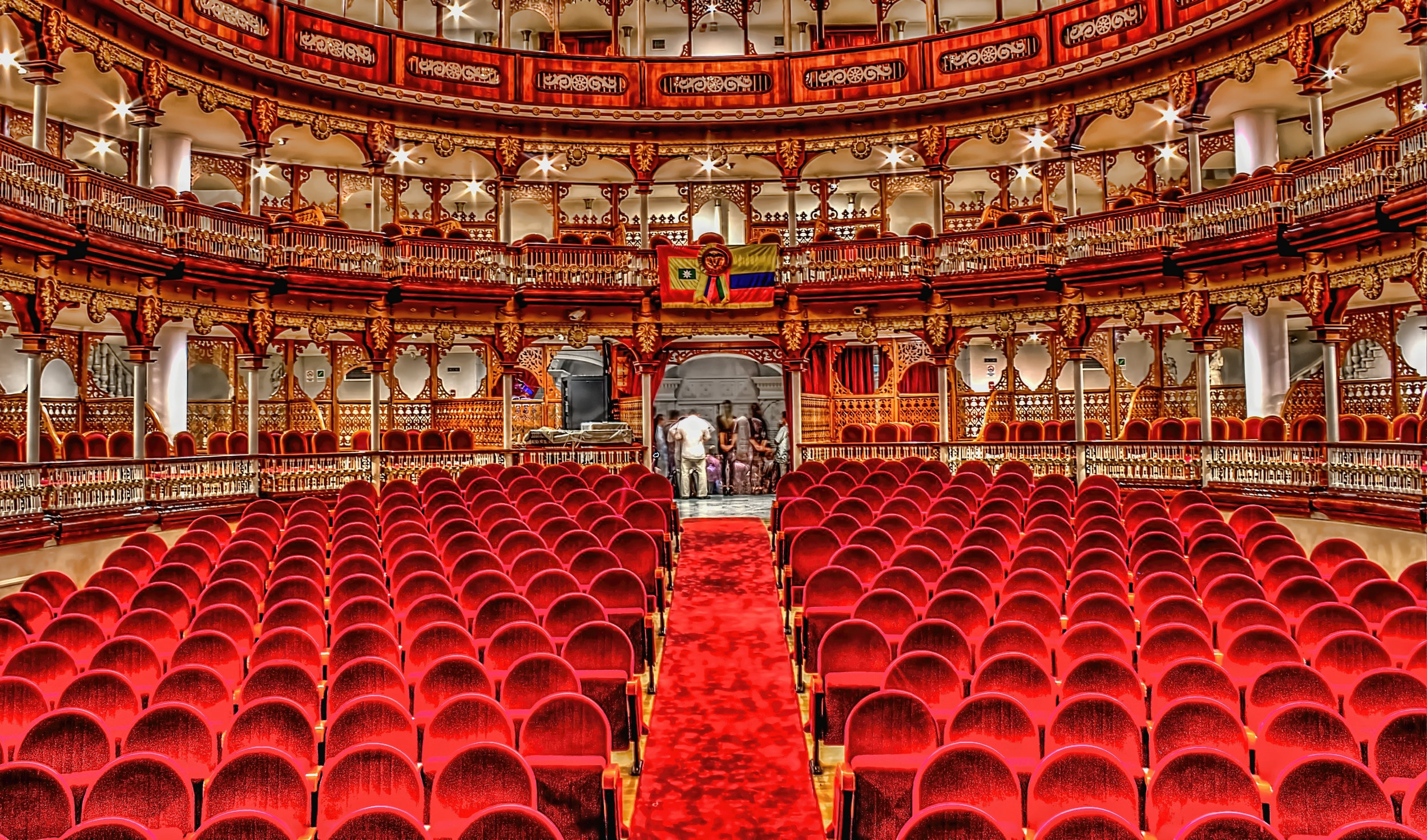 RED  TEATRO HEREDIA EN CARTAGENA. THIS IS A FAMOUSE THEATER   IN CARTAGENA THE FIRST TIME I WAS THERE WAS FOR THE CLASICAL MUSIC FESTUIVAL IN CATAGENA , I ALWAYS WANTED TO GO BACK AND TAKE SOME PICTURES. I WEN THIS YEAR FOR A RECEPTION FOR THE COLOMBIAN NEUROSURGICAL SOCIETY AND AFTER THE EVENT ENDED THERE WAS A SMALL RECEPTION . SO I WAITED TILL IT WAS EMPTY AND TOOK SOME PICTURES.    ROJO TEATRO HEREDIA EN CARTAGENA.   LO CONOCÍ POR PRIMERA VEZ EN EL FESTIVAL DE MÚSICA CLÁSICA DE CARTAGENA HACE UNOS AÑOS Y SIEMPRE QUISE VOLVER Y TOMARLE ALGUNAS FOTOS. ESTE AÑO TUVE LA OPORTUNIDAD QUE DESPUÉS DE UNA RECEPCIÓN DE LA ASOCIACIÓN COLOMBIANA DE NEUROCIRUGÍA , ME QUEDE ESPERANDO MIENTRAS TODOS IBAN A UNA RECEPCIÓN EN EL SALÓN ADYACENTE Y TUVE EL TEATRO PARA MI SOLO.
