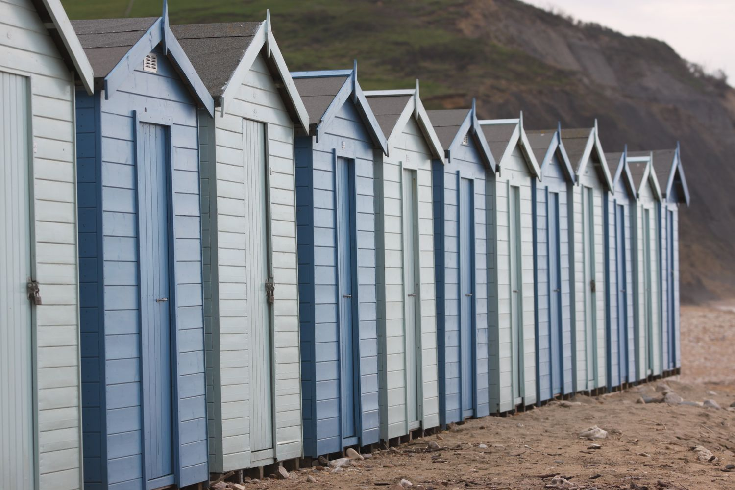 beach huts on charmouth beach