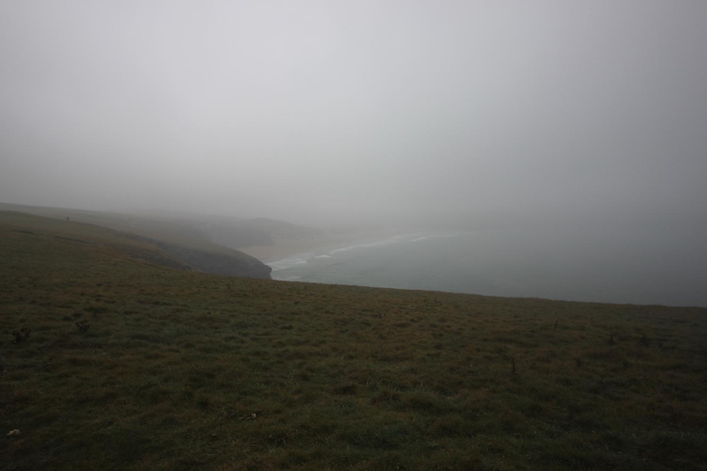 overlooking murky holywell bay