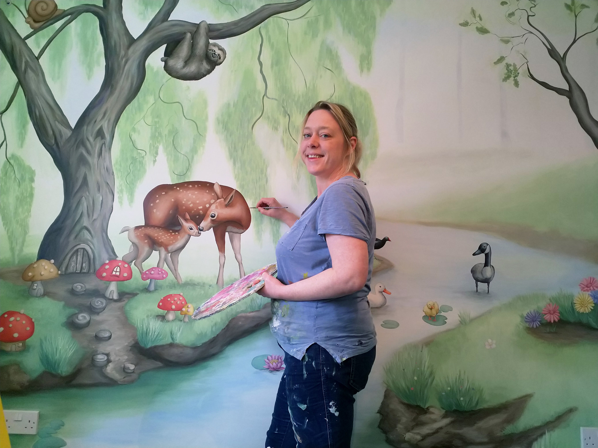 Painting woodland stream mural,